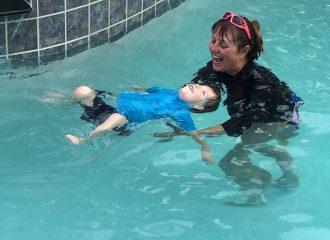 April Godwin's son demonstrates his floating skills with Miss Becky.