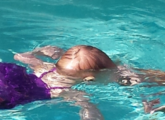 Taylor swims with Miss Becky