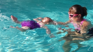 Taylor showcases swimming skills in Swim with Becky lesson.